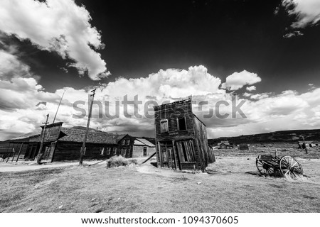 Ghost town of Bodie is a National Historic Landmark. It is located in Mono County, Sierra Nevada - California. United States of America. The town was founded in 1859. Black and white Royalty-Free Stock Photo #1094370605