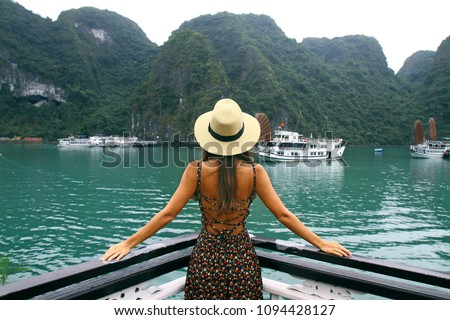 Beautiful young woman on the cruise ship across Halong Bay. Breathtaken landscape in Vietnam Royalty-Free Stock Photo #1094428127