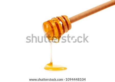 honey with wooden drizzler isolated on white background #1094448104