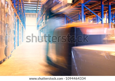 Blurred forklift driver with a pallet working in warehouse #1094464334