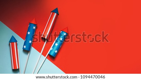 July 4, rockets for fireworks on a blue red background with space for text. in the style of minimalism #1094470046