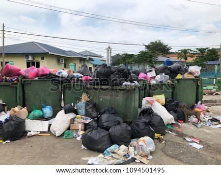 TAMPARULI, SABAH,MALAYSIA-MAY 20,2018: Editorial Use Only. Rubbish overflow outside trash containers and poor waste management. #1094501495