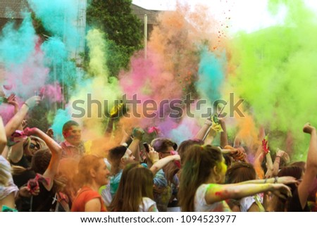 KRASNODAR, RUSSIA - May11,2018: Festival of colors, traditional Indian festival of Holi. Young people have fun during Holi holiday, throwing colorful powder. Festival of colored paint. Color festival #1094523977