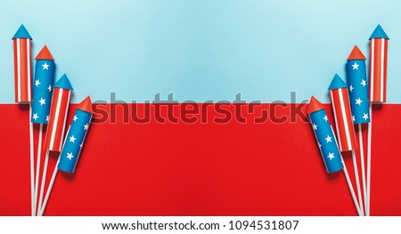 fireworks executed in the style of the American flag on a blue-red background with space for text