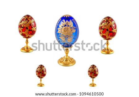 Easter eggs isolated on white - four red easter eegs and one blue easter egg #1094610500