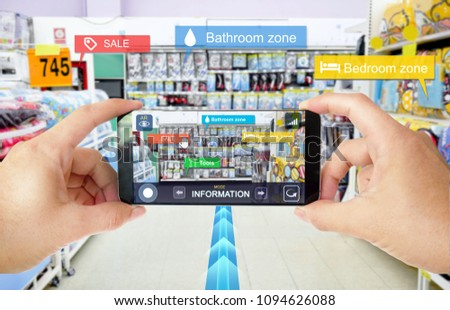 Augmented reality marketing in supermarket. Hand holding smart phone use application to navigator, check information and promotion. #1094626088