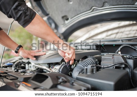 Car safety inspection and check engine accessories #1094715194