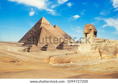 Egypt Cairo - Giza. General view of pyramids with Sphinx #1094727200