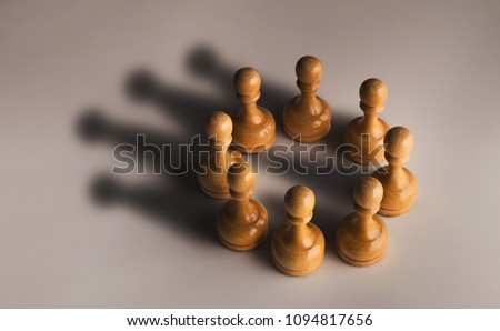Wooden chess pawn circle with shadow shaped as crown on gray background. Teamwork, group agreement and success concept #1094817656
