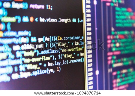 Closeup of Java Script, CSS and HTML code. Programming code abst #1094870714