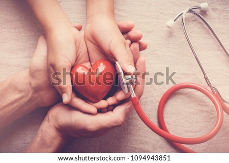 child and adult holding red heart with stethoscope, heart health,  health insurance concept, world health day, world hypertension day #1094943851