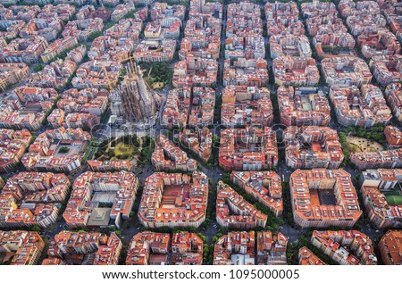 Aerial view of Barcelona Eixample residencial district and famous basilica, Spain. Late afternoon light #1095000005
