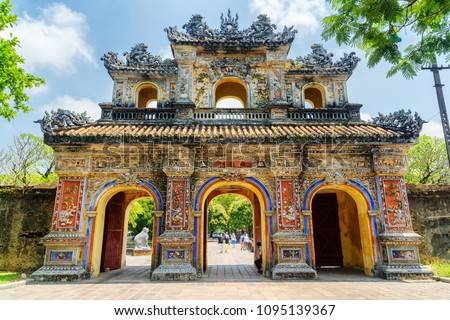 The East Gate (Hien Nhon Gate) to the Citadel with the Imperial City in Hue, Vietnam. The colorful gate is a popular tourist attraction of Hue. #1095139367
