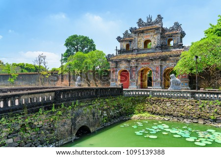 Wonderful view of the East Gate (Hien Nhon Gate) to the Citadel and a moat surrounding the Imperial City with the Purple Forbidden City in Hue, Vietnam. Hue is a popular tourist destination of Asia. #1095139388