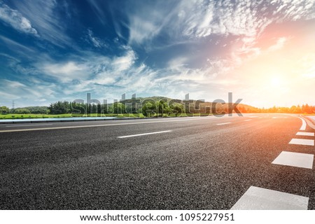 Asphalt road and mountain with sky clouds landscape at sunset #1095227951