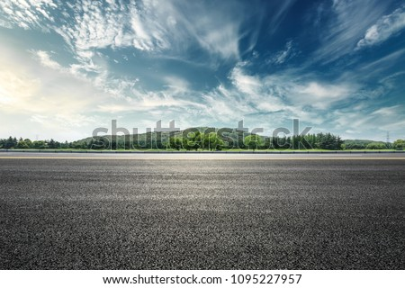 Asphalt road and mountain with sky clouds landscape at sunset #1095227957