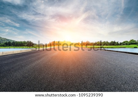 Asphalt road and forest with sky clouds landscape at sunset #1095239390