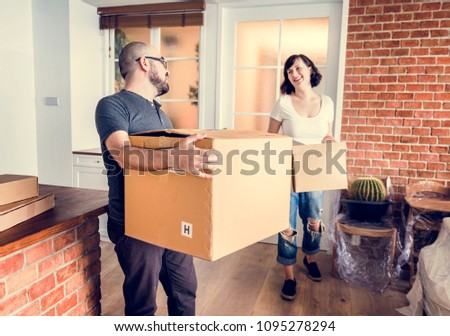 Couple moving into new house #1095278294