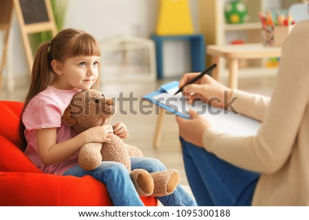 Cute little girl at child psychologist's office Royalty-Free Stock Photo #1095300188