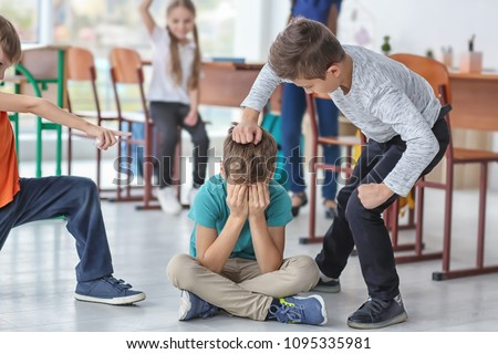 Children bullying their classmate in school #1095335981