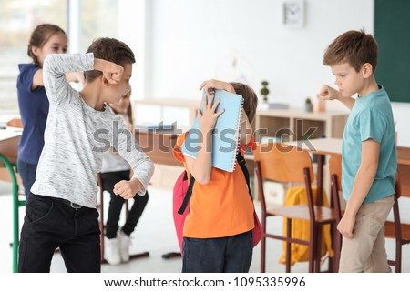 Children bullying their classmate in school #1095335996