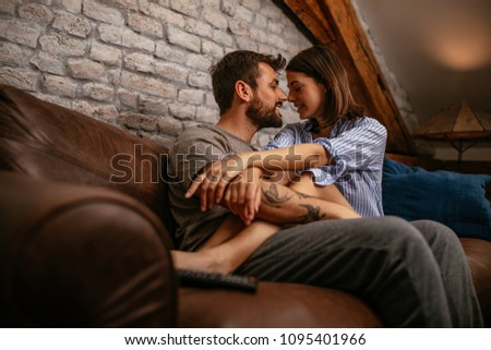 Young affectionate couple relaxing at home #1095401966