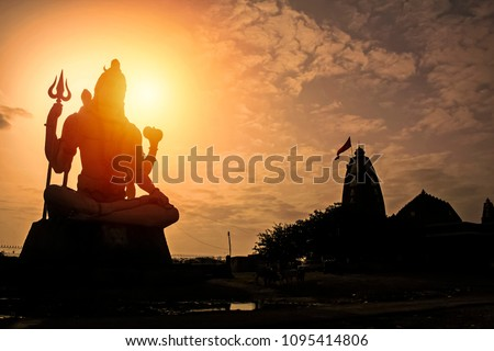 Giant sculpture of Shiva Nageshwar at the famous Nageshwar temple close to Dwarka. Gujarat. India. #1095414806