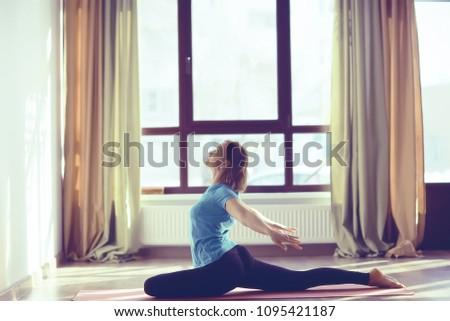 yoga girl sports hall / sport stretching, beautiful girl doing sports in the gym, yoga balance #1095421187