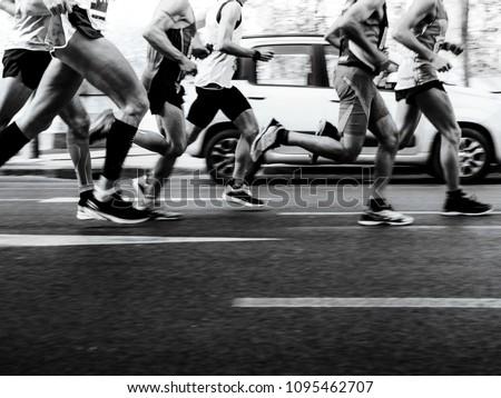 group men runners running street on marathon black-and-white image #1095462707