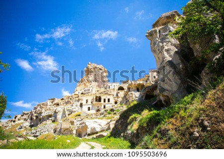 City landscape. Ancient rocks in a settlement in the territory of Cappadocia, Turkey. For printing tourist brochures, articles and postcards. #1095503696