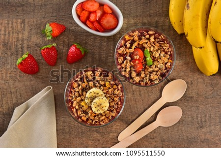 Acai berry cups on wooden background #1095511550