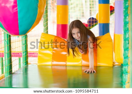 Cute little girl is playing on the playground. #1095584711