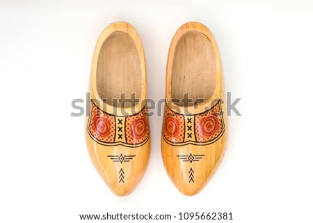Traditional dutch wooden clogs isolated on the white background #1095662381