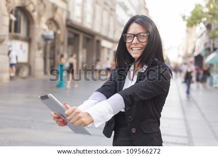 Beautiful Woman Using Tablet Computer #109566272