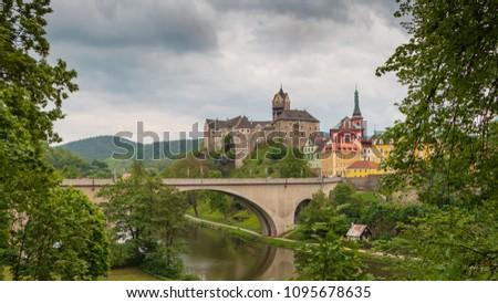 Loket Castle on the Eger River. Romantic castle with colourful houses. Knight's castle in Czech Republic #1095678635