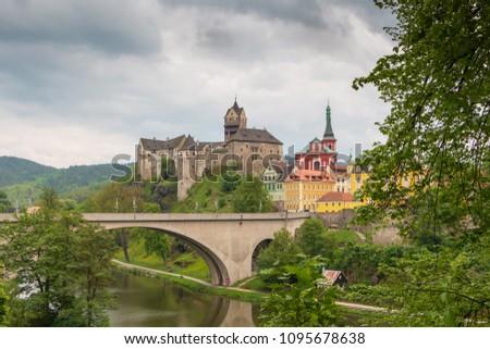 Loket Castle on the Eger River. Romantic castle with colourful houses. Knight's castle in Czech Republic #1095678638