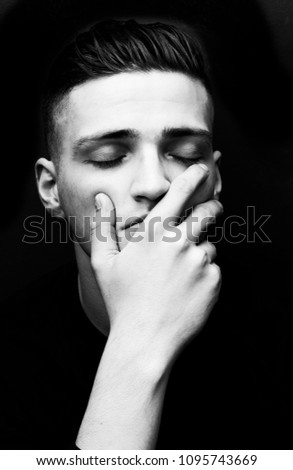 High contrast photograph of young man millennial overcome by his issues #1095743669