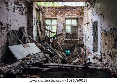 Old rotten lost abandoned house. Ruined roof and floor.  #1095769013