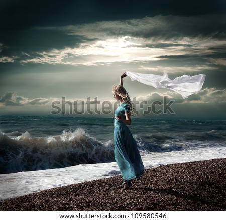 Dark Photo of Blonde Woman with White Scarf at Stormy Sea #109580546