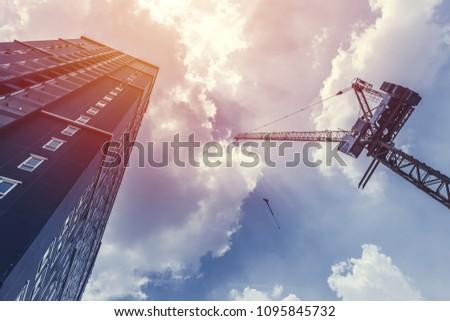 construction crane and hight building condominium against the blue sky #1095845732