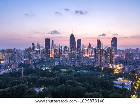 Cityscape of Wuhan city at night.Panoramic skyline and buildings in financial district. Royalty-Free Stock Photo #1095873140