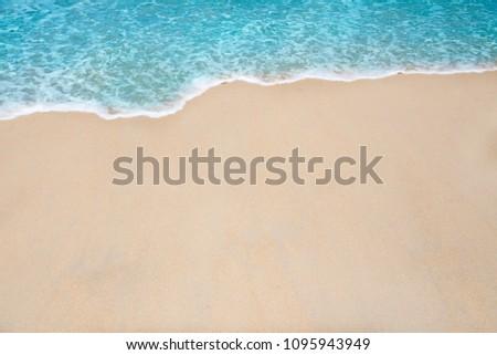 Soft wave and sea bubble of blue sea on sandy beach #1095943949