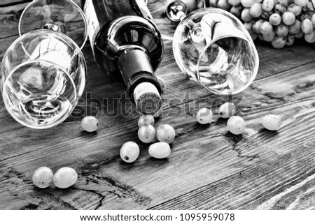 Wine and grapes. White wine in a bottle and in glasses. Still life