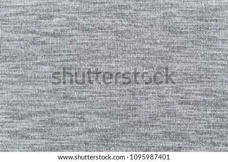Black and gray polyester fabric, seamless pattern background.The main object for making sport clothes,worm pant,jacket and others.Picture suitable for designer,Tailor shop.
