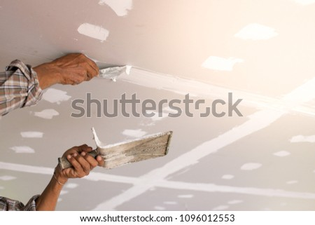 Hands of Workers are repairing the ceiling #1096012553