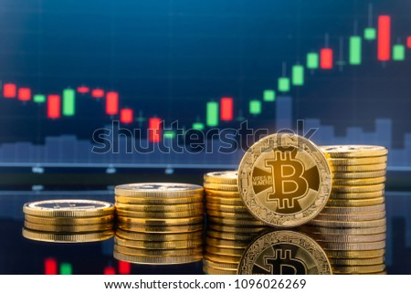 Bitcoin and cryptocurrency investing concept - Physical metal Bitcoin coins with global trading exchange market price chart. #1096026269