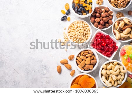 Nuts and dried fruits assortment on stone table top view. #1096038863