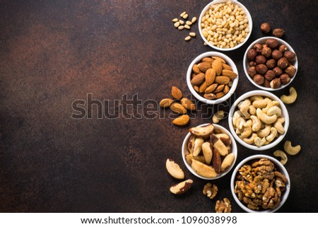 Nuts assortments on stone table top view. #1096038998