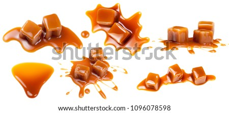 Flowing caramel sauce isolated on white background. Golden Butterscotch toffee caramel liquid  #1096078598