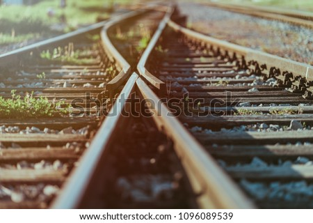 Railway crossroads. Choosing the right pathy, making decision, having doubts, choice way concept. Shallow depth of field. #1096089539